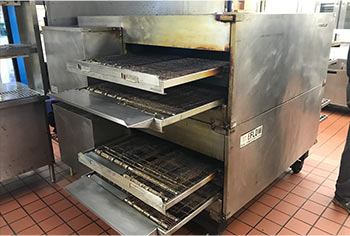 Old EFLOW commercial oven prepped for removal